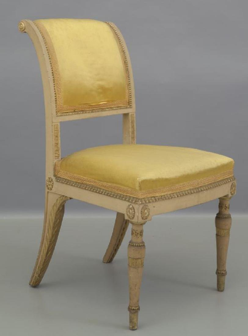 Quattro sedie in legno intagliato, dorato e