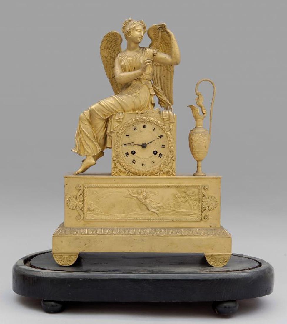 Orologio Carlo X in bronzo dorato con figura