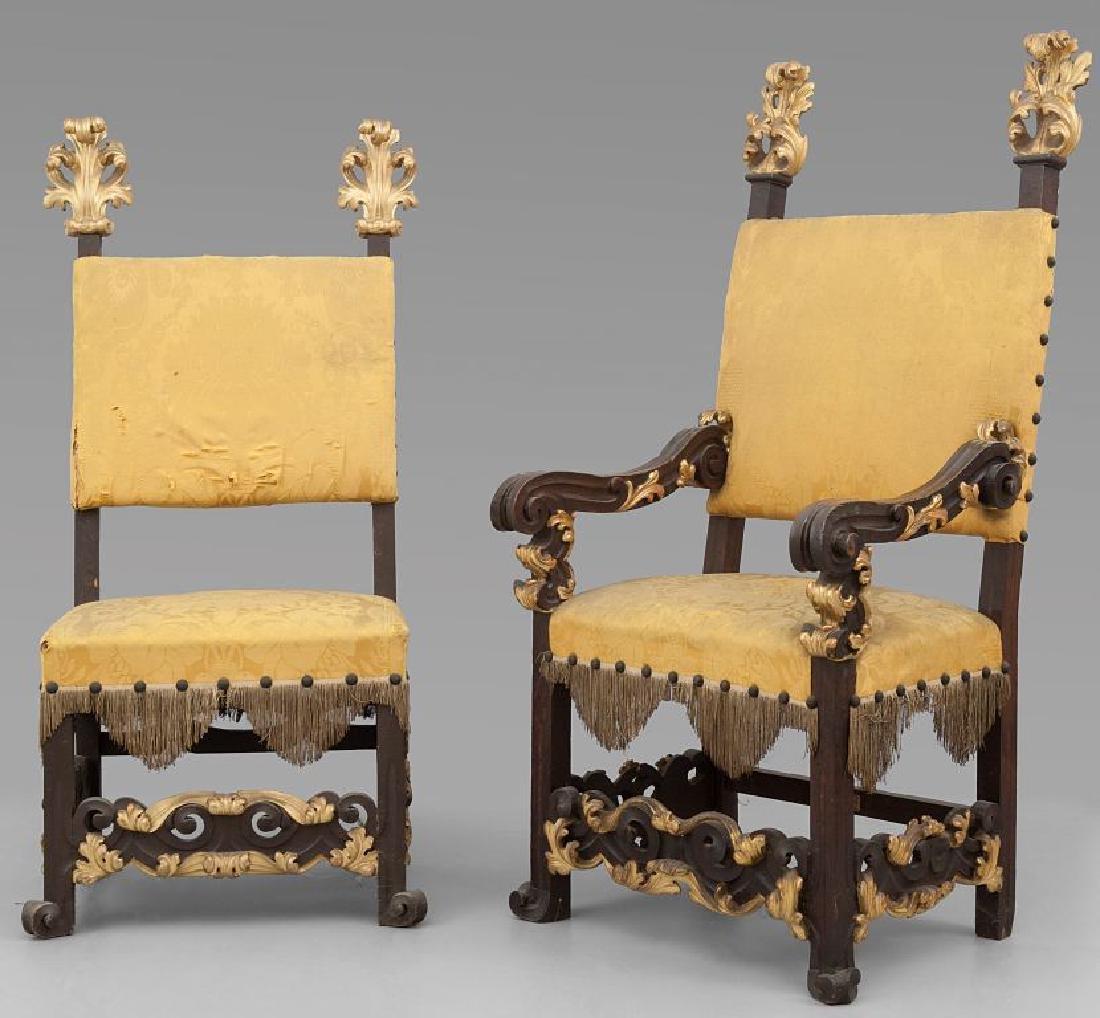 Poltrona e tre seggioloni in legno intagliato e