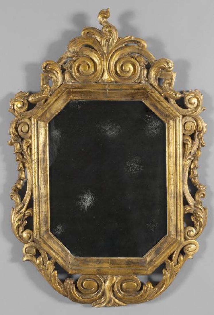 Specchiera in legno intagliato e dorato,
