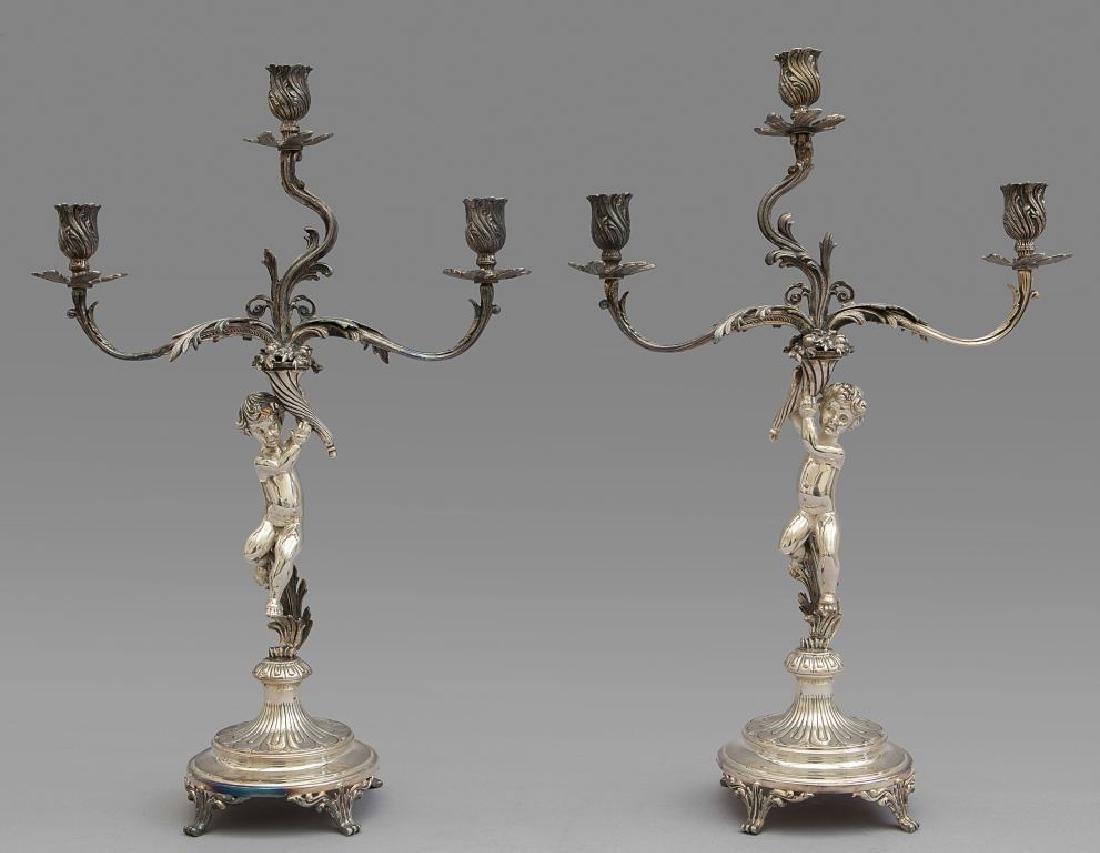 Coppia di candelieri in argento a tre luci