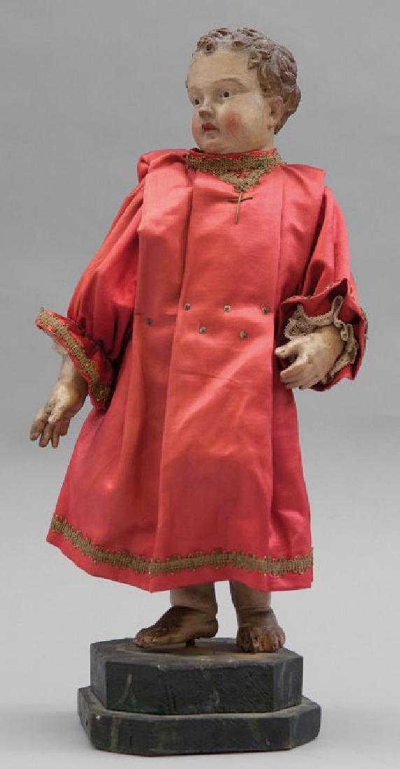 Bambino, scultura in terracotta con vestito in