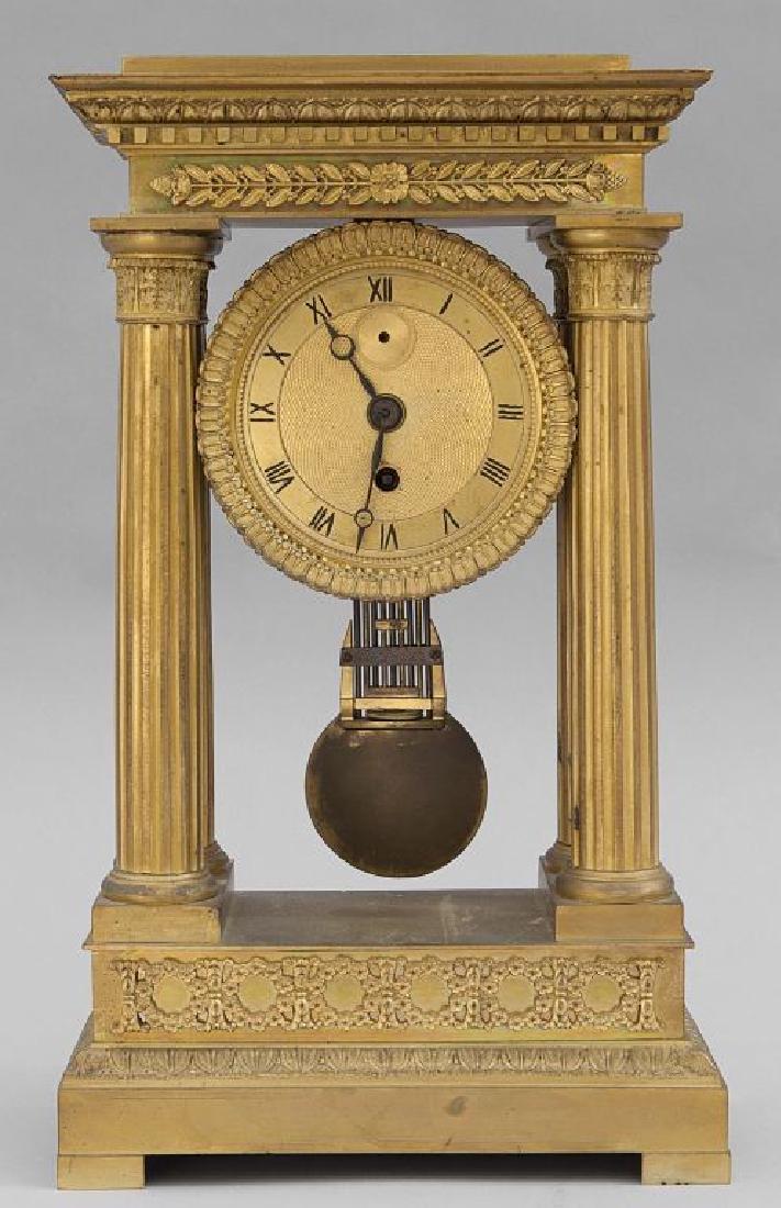 Orologio Carlo X in bronzo dorato,