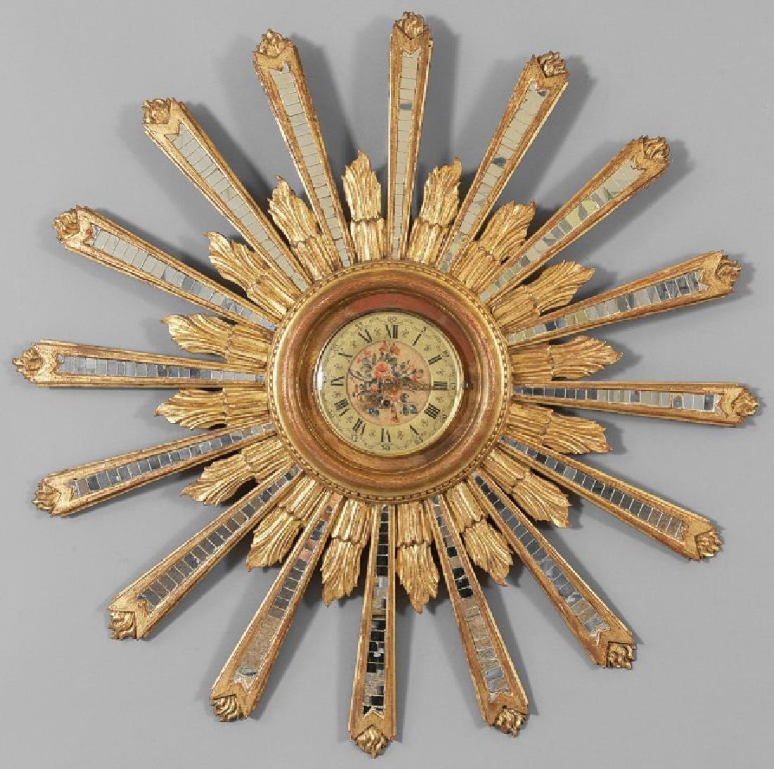 Raggiera in legno intagliato e dorato con specchi