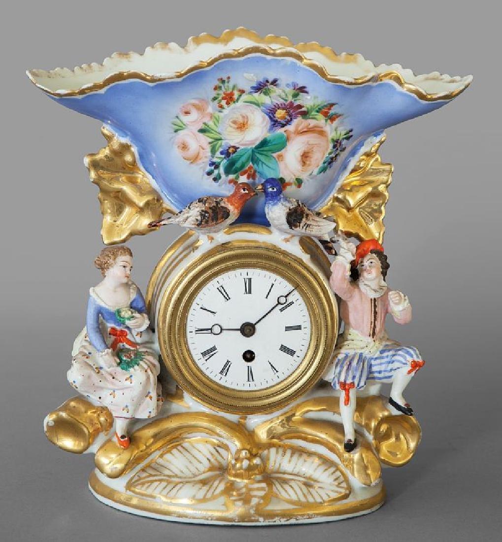Portafiori con orologio in porcellana policroma,