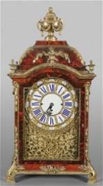 Importante orologio in legno lastronato in