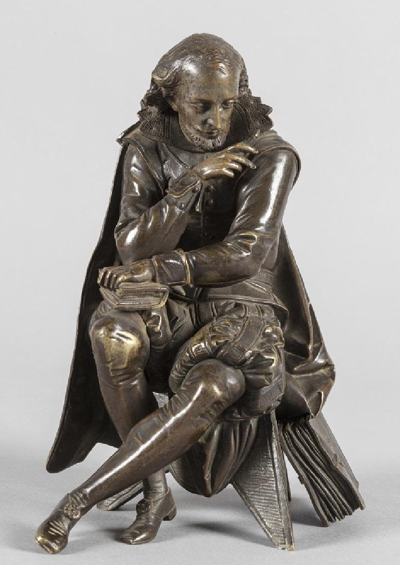Scrittore, scultura in bronzo a patina scura,