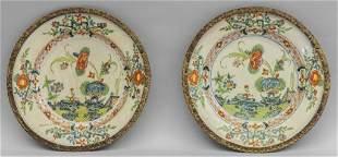Coppia di piatti in ceramica plicroma a fiori con