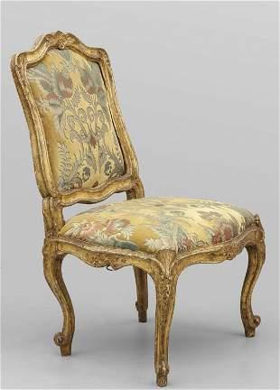 Sedia Luigi XV in legno finemente intagliato e