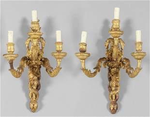 Coppia di apliques Luigi XVI a tre luci in legno