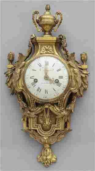 Orologio a Cartel Luigi XV in bronzo dorato fto