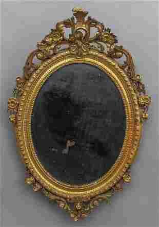 Specchiera ovale in stile Luigi XV in stucco