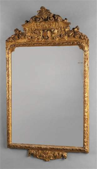 Specchiera Luigi XV in legno finemente intagliato