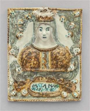 Placca in ceramica policroma raffigurante Santa
