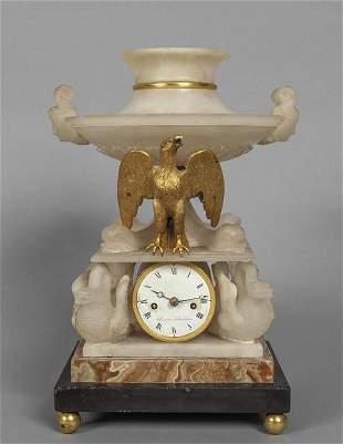 Curioso orologio in alabastro bronzo dorato e
