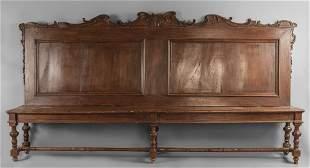 Grande panca Luigi XIV in noce intagliato con