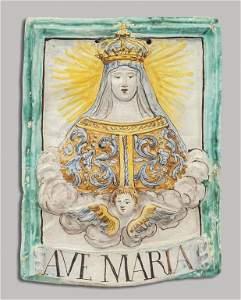 Placca in maiolica raffigurante busto della