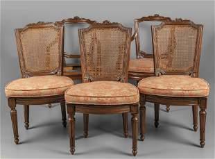 Due poltrone e tre sedie Luigi XVI in noce