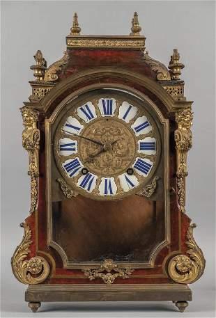Orologio Luigi XIV in legno ebanizzato e