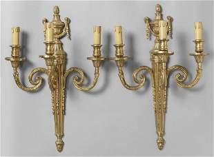 Coppia di apliques in stile Luigi XVI in bronzo
