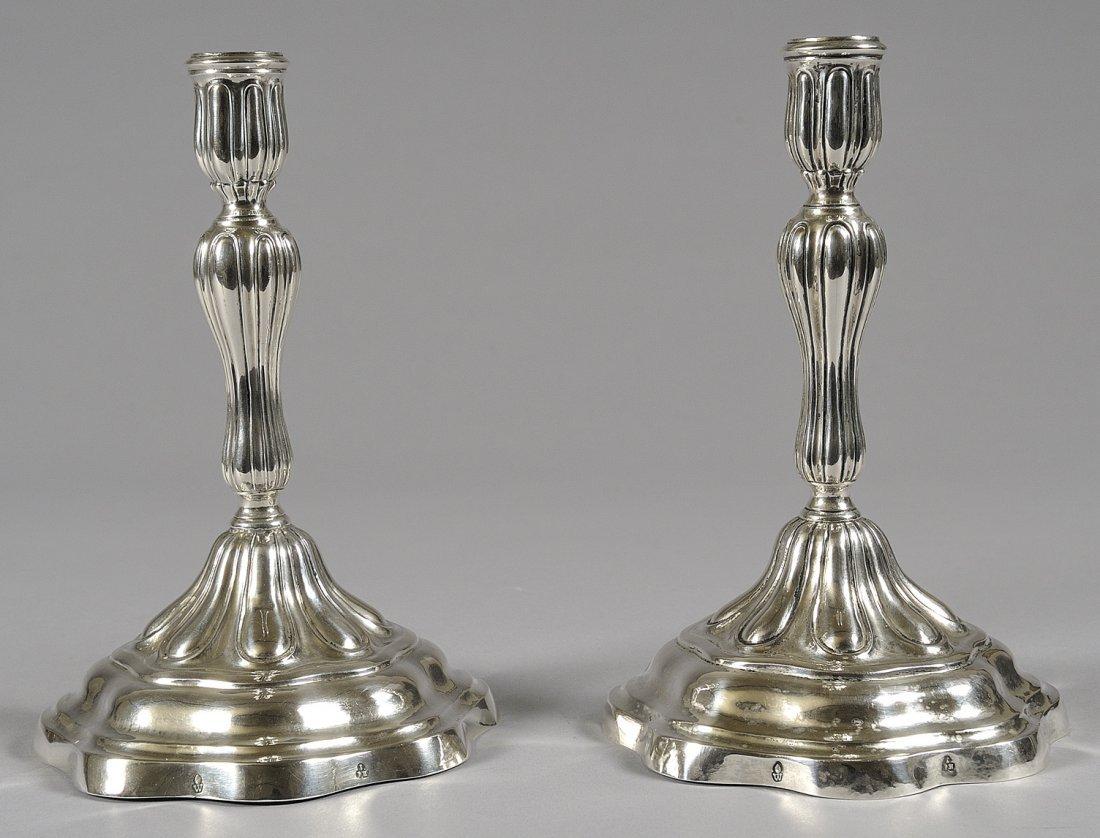 Coppia di candelieri Luigi XV in argento punzone