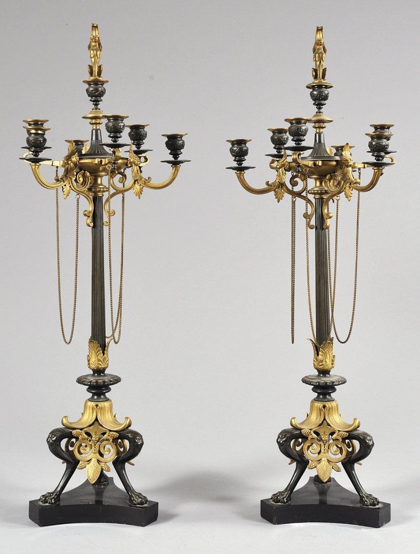 Coppia di candelabri in bronzo dorato e  brunito