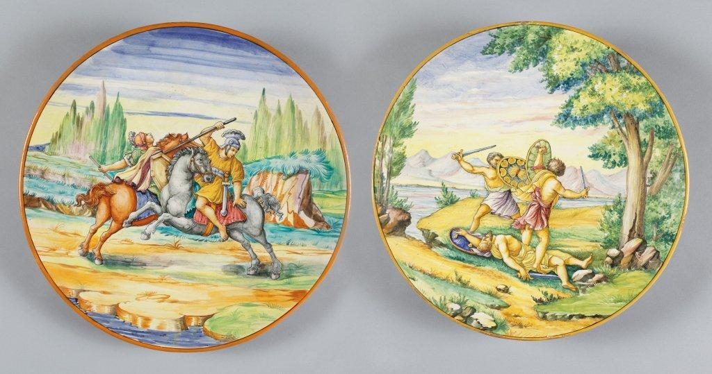 Due piatti in ceramica raffiguranti paesaggi f.ti