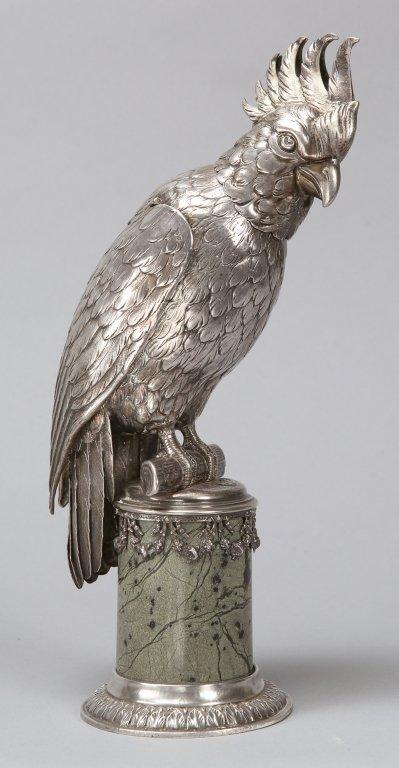 Pappagallo in argento con base a colonna in
