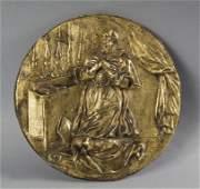 Santo orante, placca rotonda in bronzo dorato e