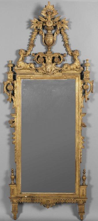 Specchiera Luigi XVI in legno intagliato e