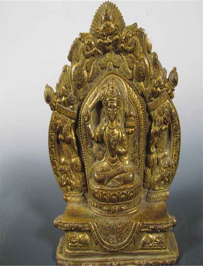 A CARVED BRONZE FIGURE OF TRADITION RELIGION BUDDHA