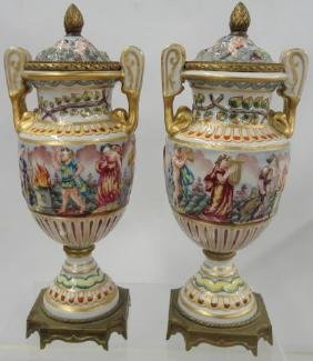 *PAIR OF CAPODIMONTE PORCELAIN COVERED URNS