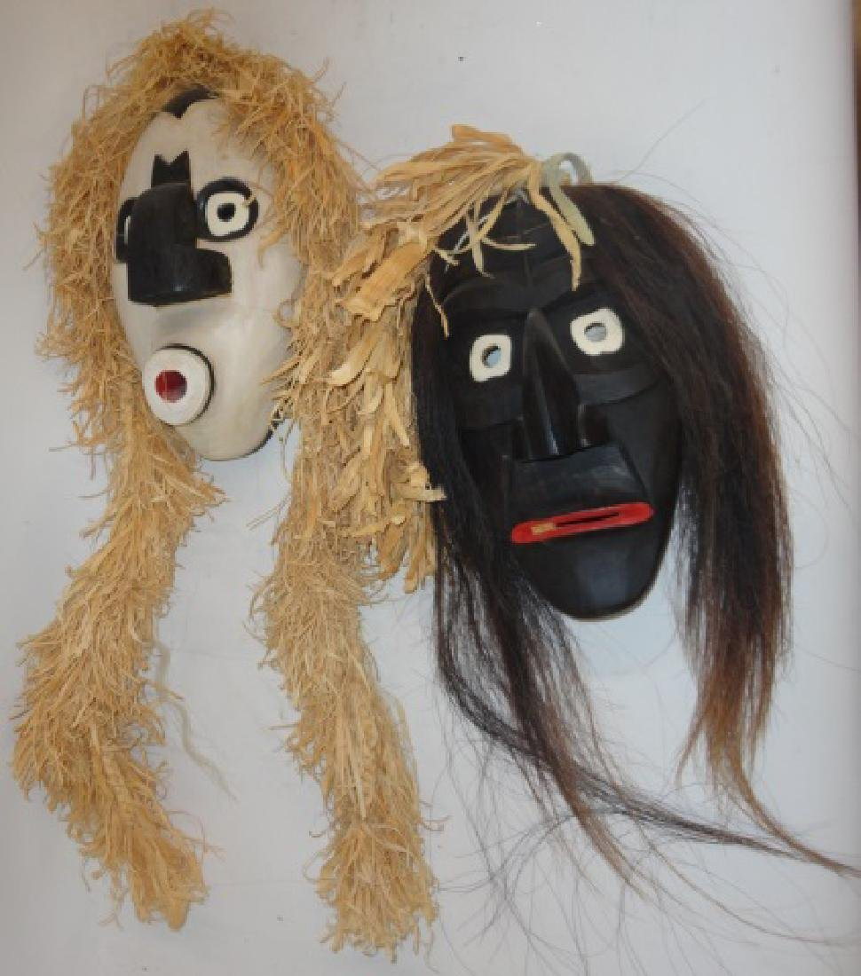 *2 CARVED MASKS