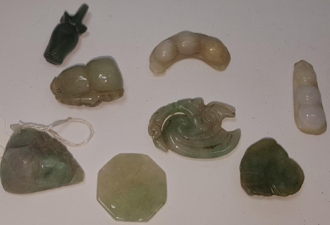 8 SMALL CARVED GREEN STONE PENDANTS