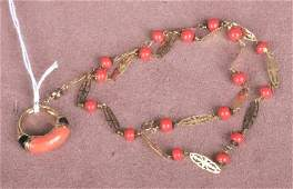 1424 GROUP OF YELLOW GOLD AND CORAL JEWELRY Comprisin