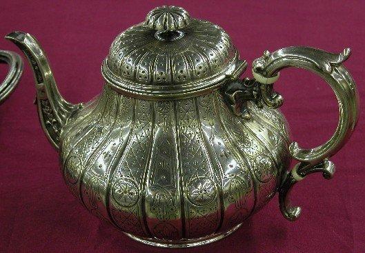 1005A: SEVEN PIECE ELKINGTON STERLING SILVER TEA AND CO