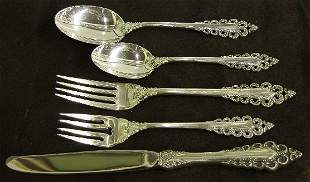 THIRTY-SIX PIECES OF LUNT STERLING SILVER FLATWAR