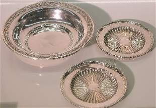 THREE PIECES OF STERLING SILVER  Comprising a sha