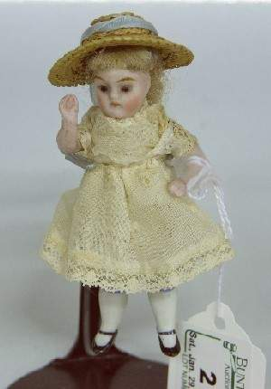 ***ALL BISQUE MINIATURE DOLL| Having glass eyes with