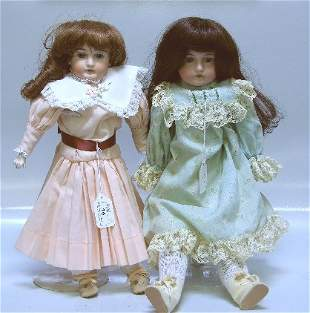 TWO BISQUE HEAD DOLLS| One having open mouth with t