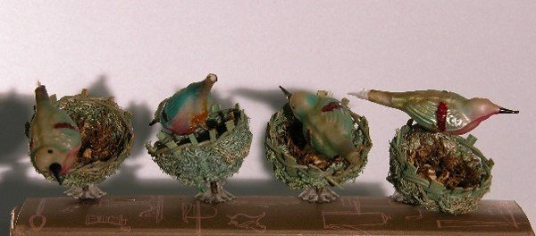 3007: ***FOUR BIRDS ON NEST| Glass birds with wicker ba