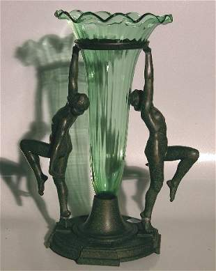 ART NOUVEAU SPELTER VASE  Having green glass trum