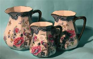 SET OF THREE LOSOL WARE PITCHERS  Decorated with