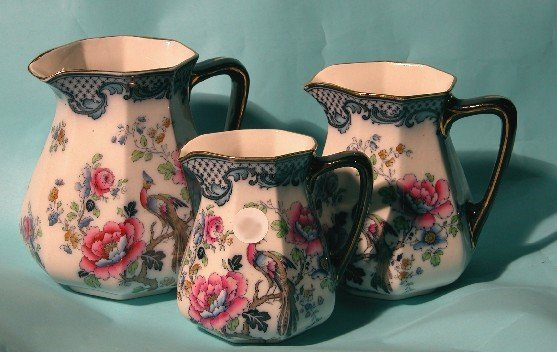 4012: SET OF THREE LOSOL WARE PITCHERS  Decorated with