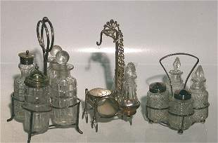 THREE SILVERPLATE AND GLASS CRUET SETS  One fitte