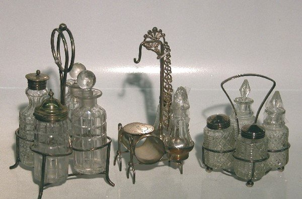 4017: THREE SILVERPLATE AND GLASS CRUET SETS  One fitte