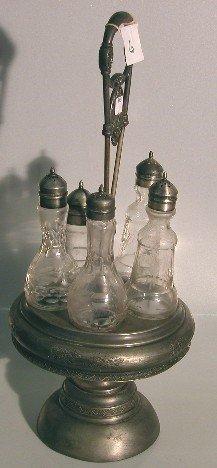 4018: VICTORIAN CRUET SET  Having 5 bottles with etched