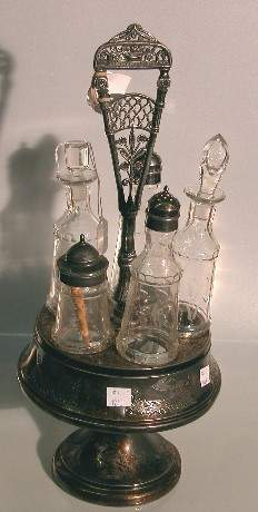VICTORIAN CRUET SET  Fitted with 5 bottles having