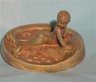 POTTERY FIGURAL ''FROG''  Depicting child laying