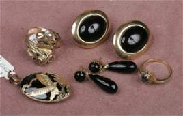 GROUPING OF 14K GOLD JEWELRY| Comprising a drago